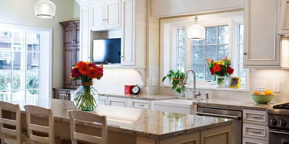 Bright flowers accent white kitchen cabinets