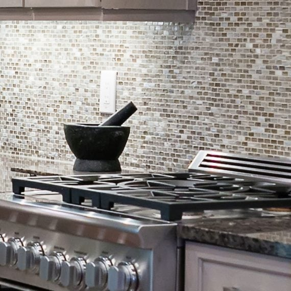 modern kitchen range against small tiled backsplash in renovated kitchen