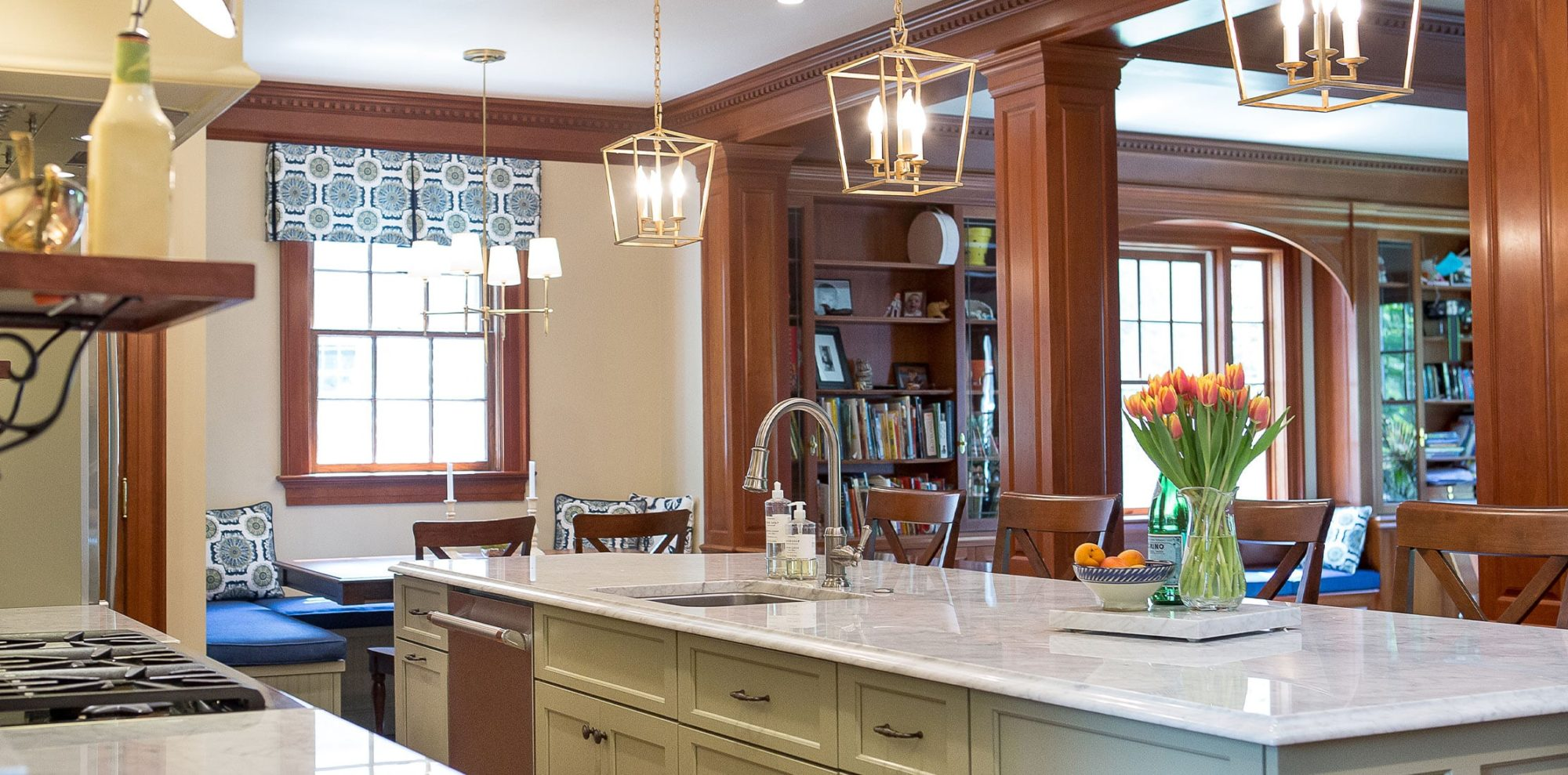 Open concept kitchen with pendant lights