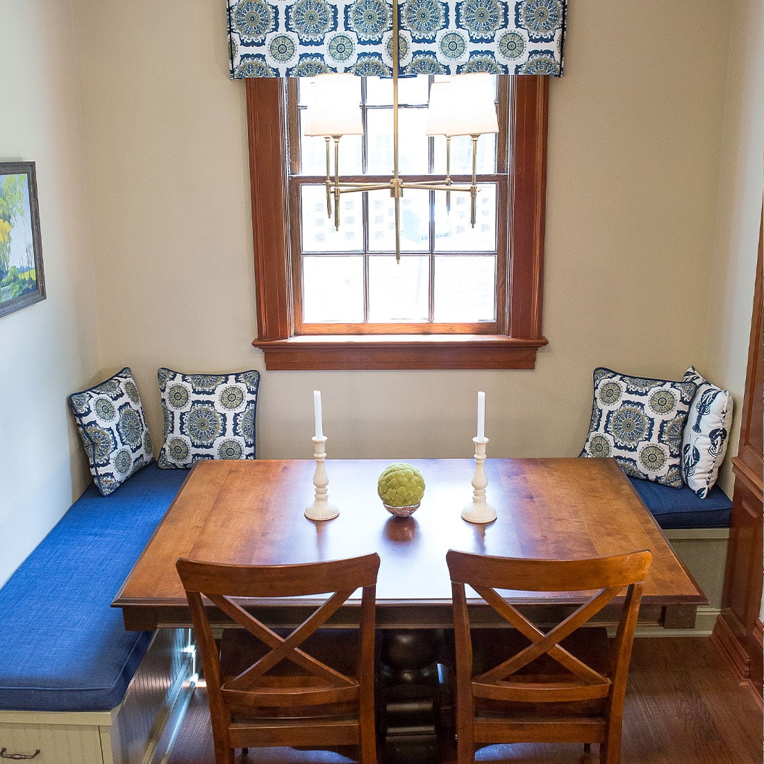 Blue cushioned breakfast nook in renovated kitchen