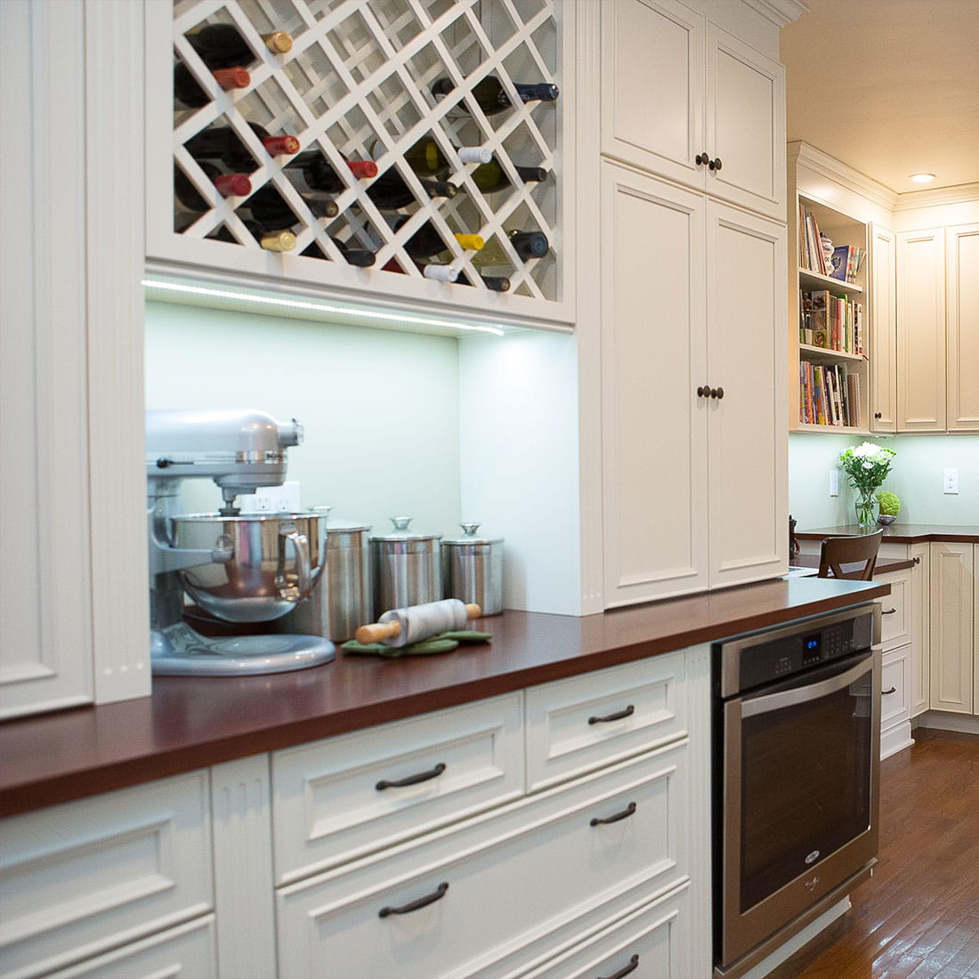 Built in storage nook with wine rack in renovated kitchen