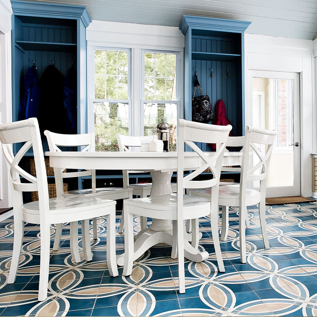 White table set contrast blue and yellow pattern tile in sunroom