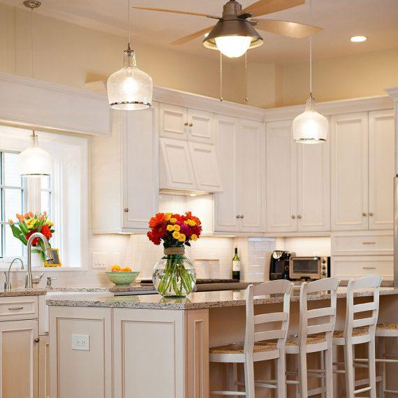 Bright flower arrangements in newly renovated kitchen