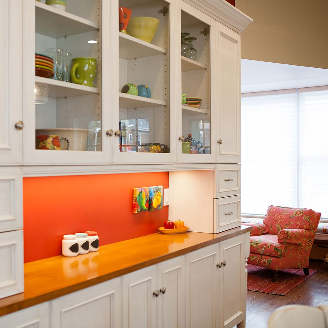 Orange pop of color in renovated kitchen