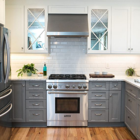 white tile backsplash in grey and white renovated kitchen