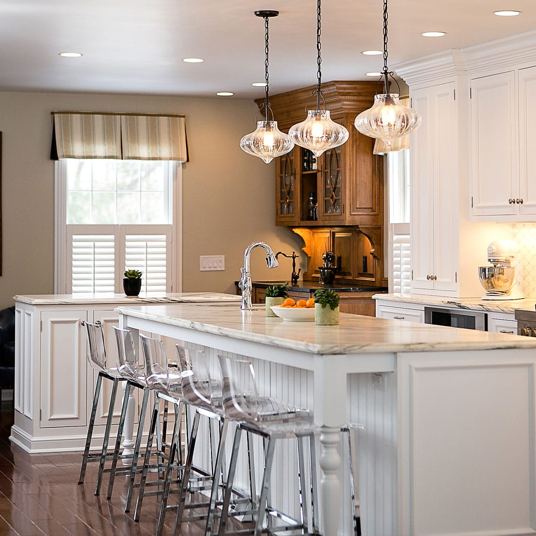 double white marble island in renovated kitchen
