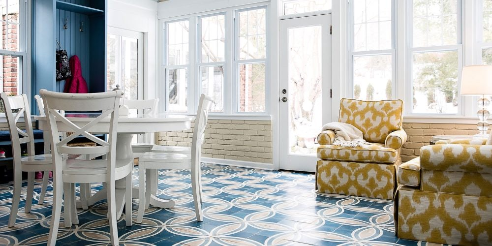 Yellow lounge chairs against blue patterned tile in sunroom renovation