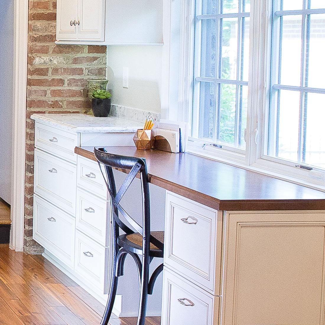 built in desk in renovated kitchen