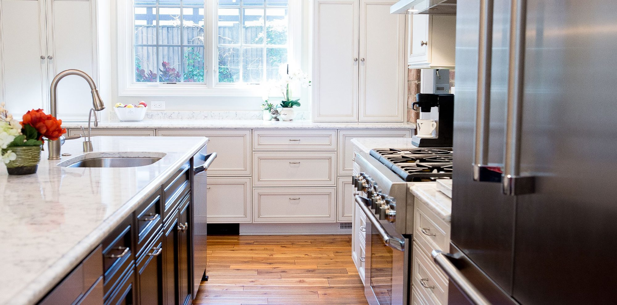 White and brown contrasting cabinets in renovated kitchen