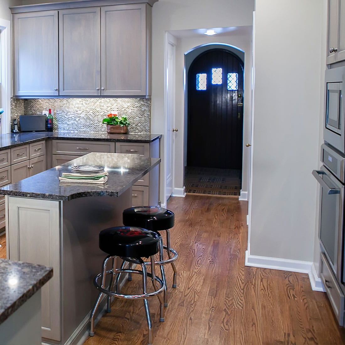Classic barstools under dark marble kitchen island