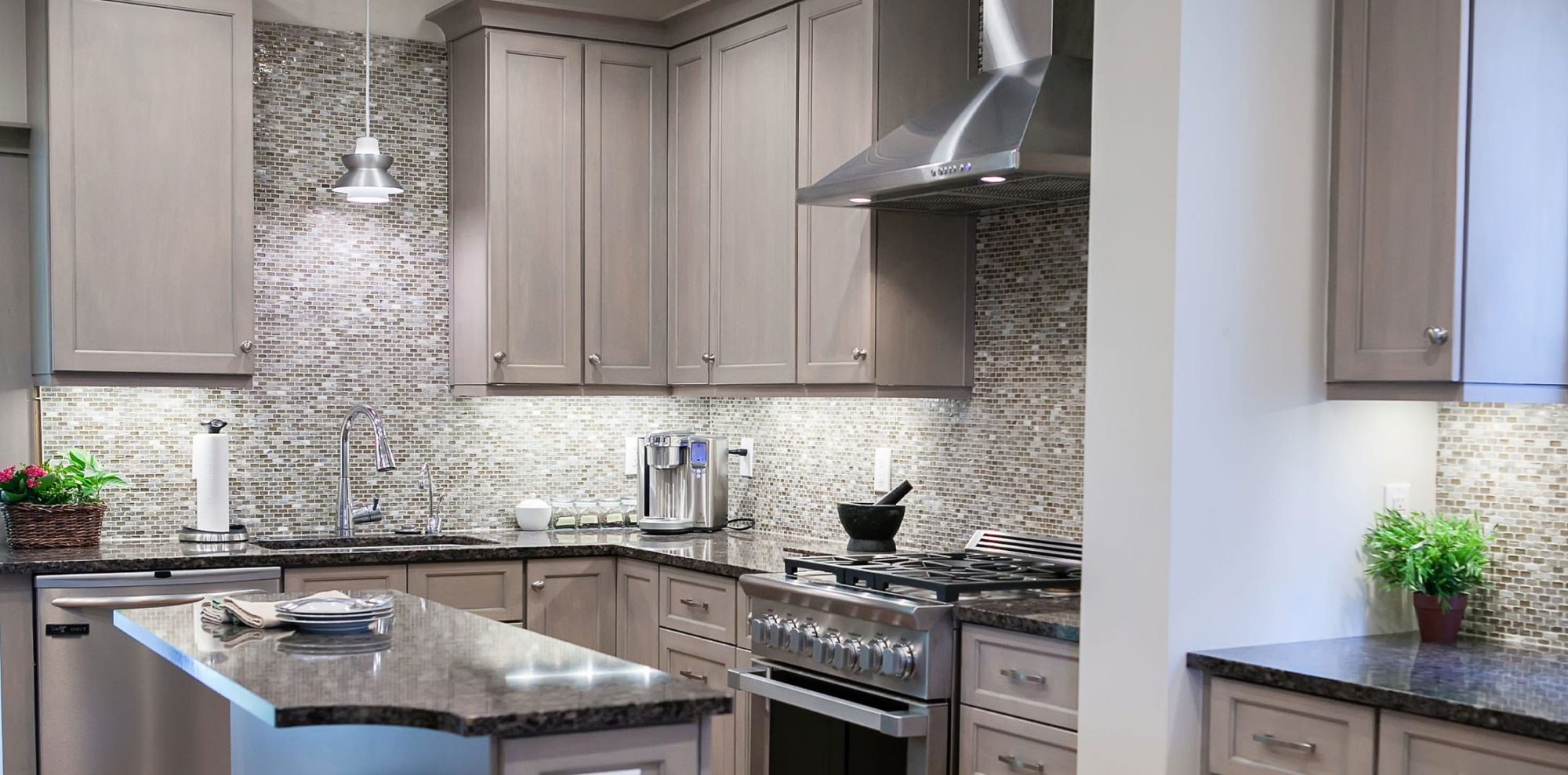 Cool gray kitchen with counter to ceiling backsplash in renovated kitchen