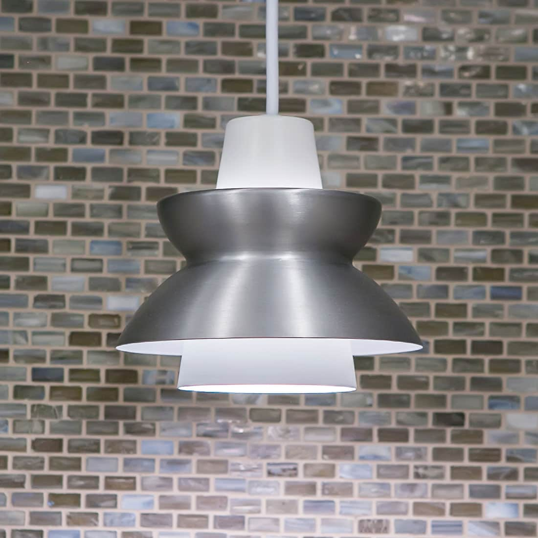Modern nickel pendant light in renovated kitchen