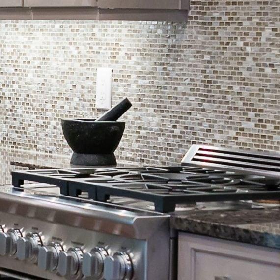 modern kitchen range against small tiled backsplash in renovated kitchen