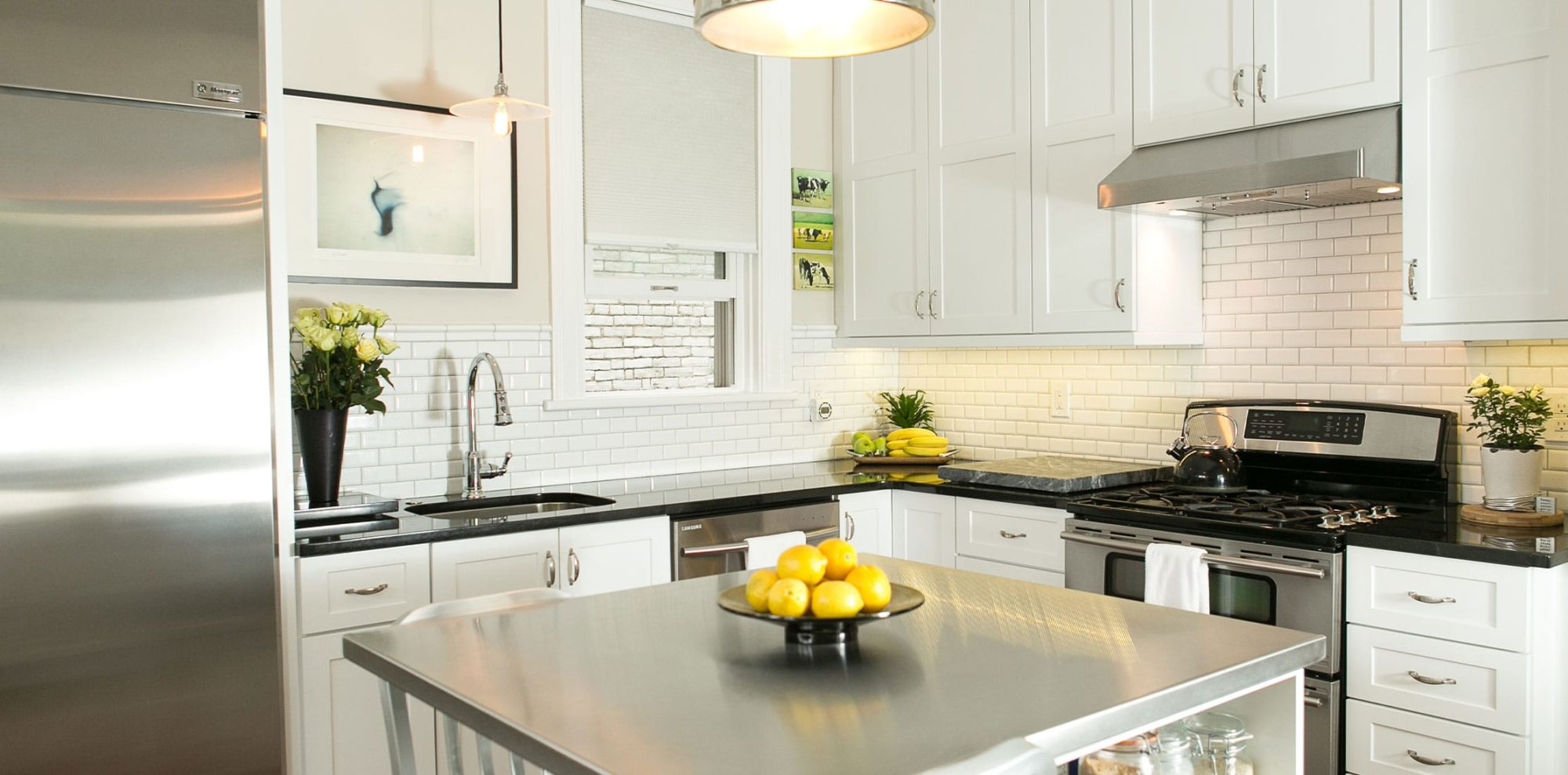 Stainless steel appliances with matching island in white renovated kitchen
