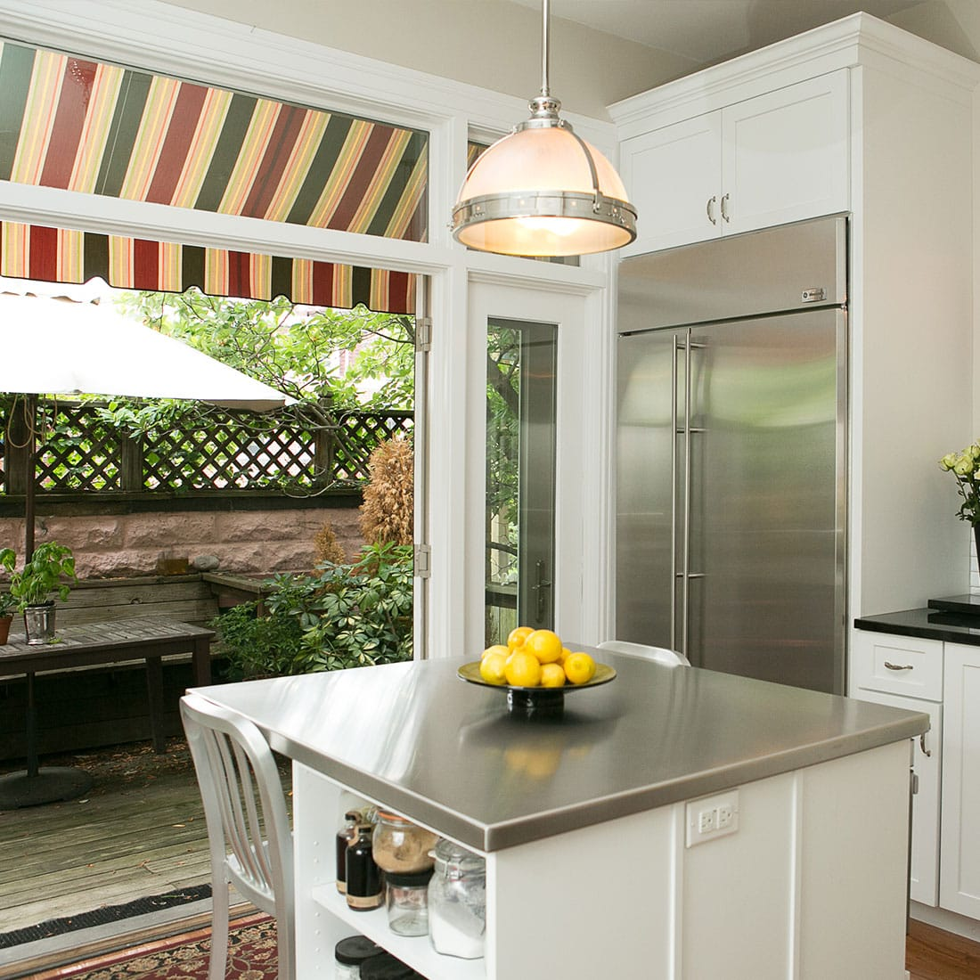 Large kitchen doors open to outdoor area in renovated kitchen