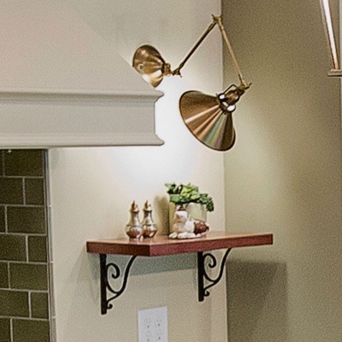 Work lights over shelf in renovated kitchen
