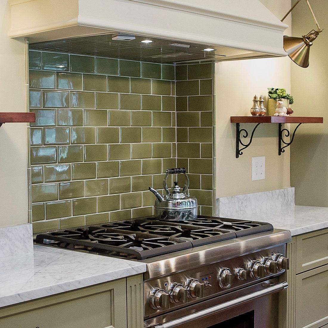 modern kitchen range with green tile backsplash in renovated kitchen
