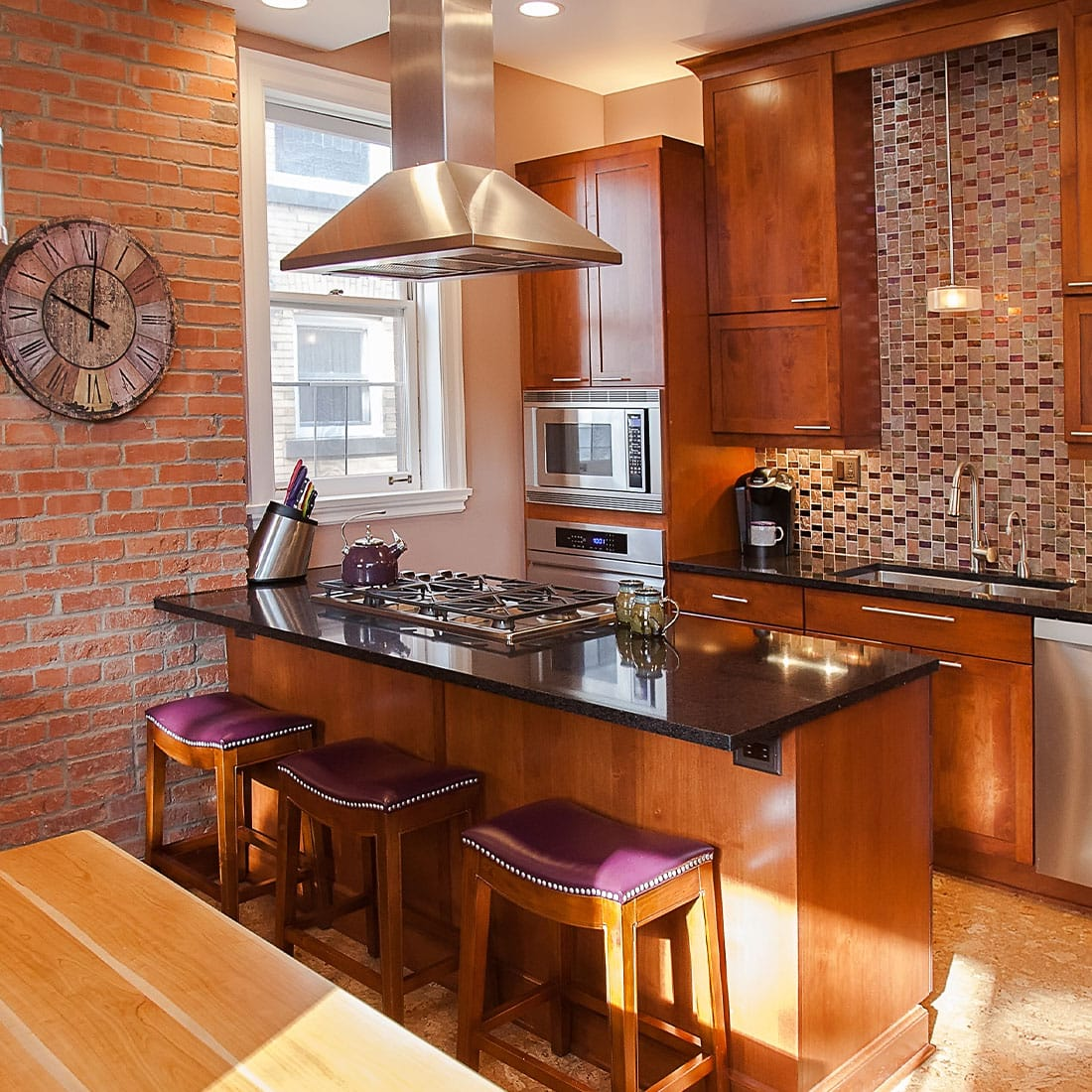 Open concept kitchen with warm cherry wood