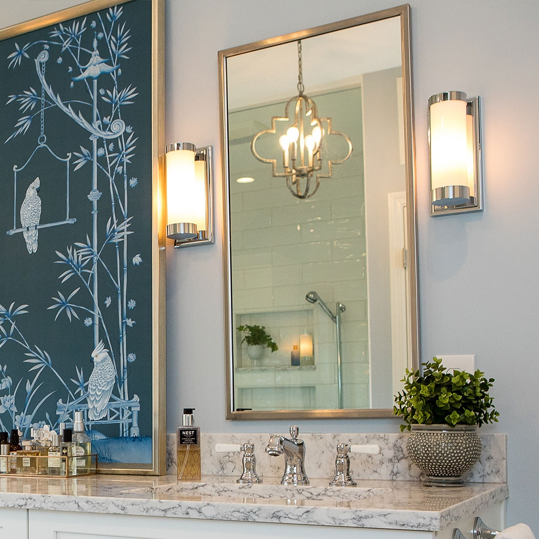 reflection on unique brass pendant light in renovated bath