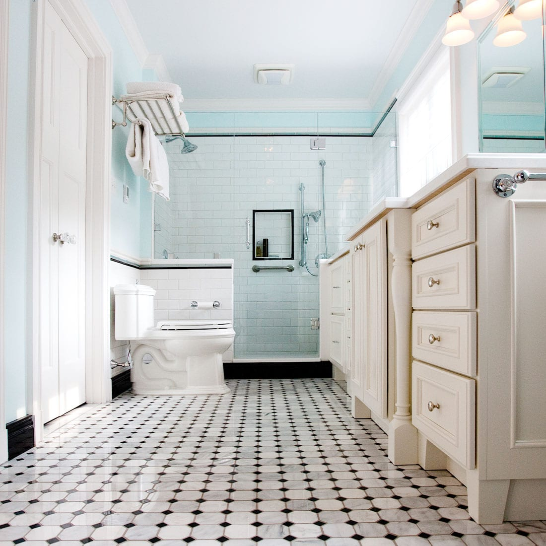 White and black bath with teal accents in renovated bath