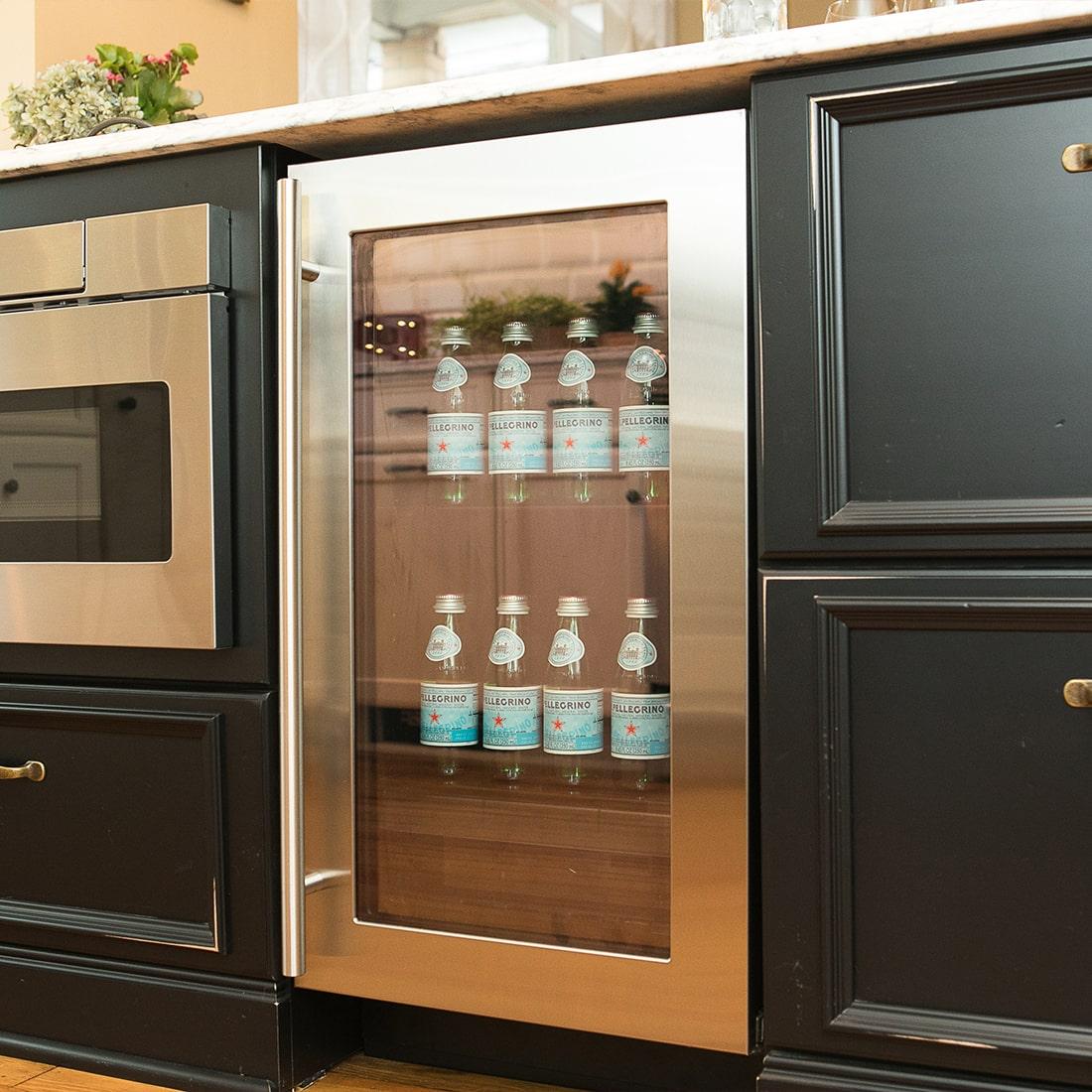 Built in mini fridge in island of renovated kitchen