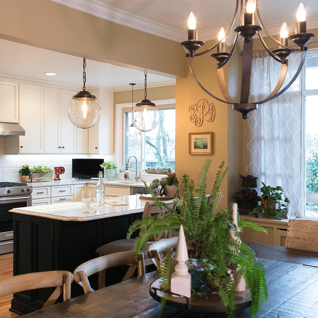 Dark hardware contrast white cabinets in renovated kitchen