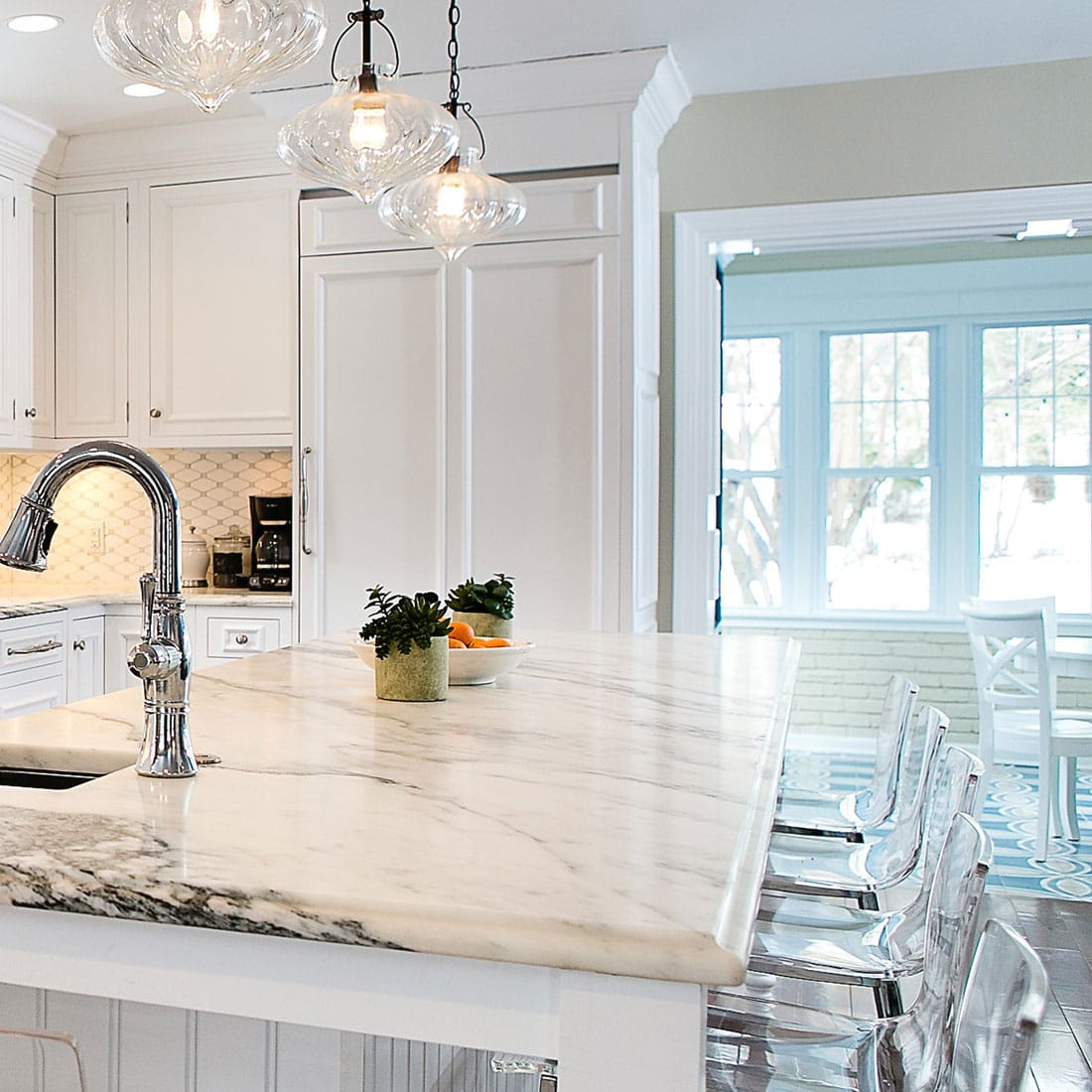 White marble counter with view of bright sunroom